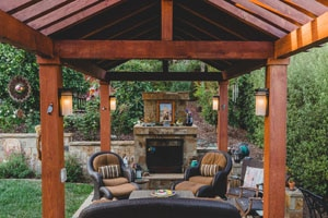 Contemporary Backyard Pergola with Fireplace