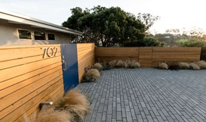 Contemporary Wood Plank Fencing and Parking Area
